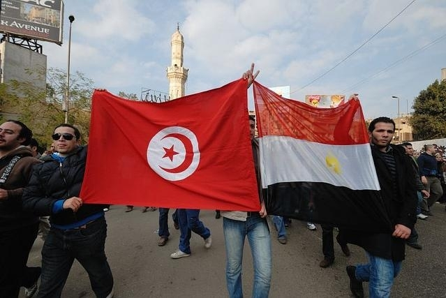 25 January: The Tunisian and Egyptian flag held aloft © Demotix / Nour El Refai